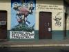 León und Wandgemälde zur Erinnerung an die Ermordung von 4 Studenten durch das von den USA unterstützte Somoza-Regime